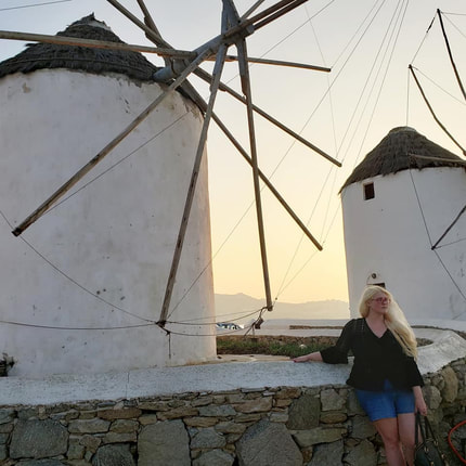 Actress, writer, Tracy Cahill at the windmills in Mykonos.